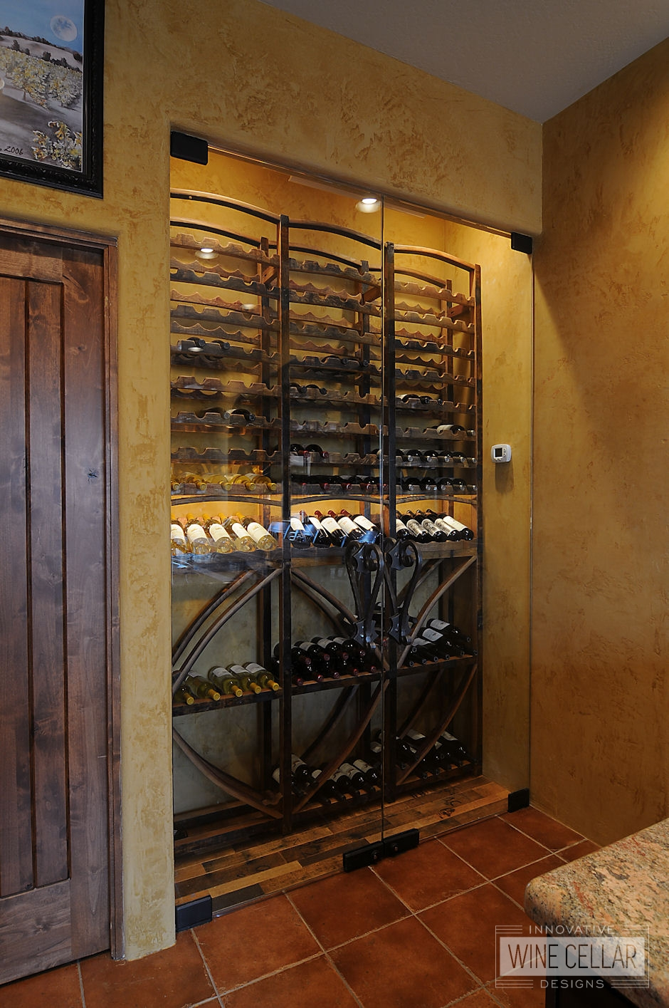 Reclaimed wine barrel racking in recessed glass wine cellar, design & install by Innovative Wine Cellar Designs.