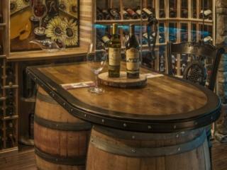 Wood Racking & Reclaimed Wine Barrel Tasting Table by Innovative Wine Cellar Designs