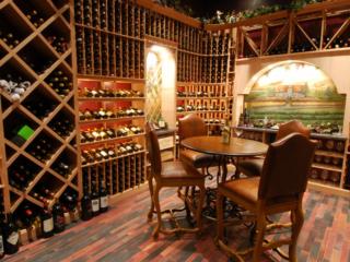 Custom Wine Tasting Room and Wine Racks by Innovative Wine Cellar Designs