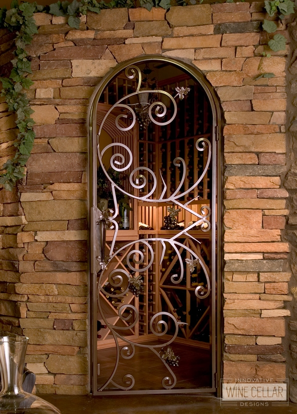 Custom Wood Wine Racks shown through Custom Wine Room Iron Door