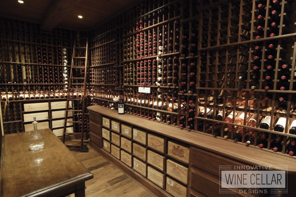 Dark Wooden Wine Racks in Dim Lit Custom Built Wine Cellar by Innovative Wine Cellar Designs
