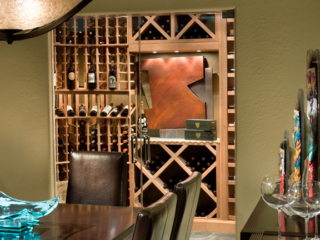 Custom Wood Wine Racks in Brightly Lit Wine Room with Art