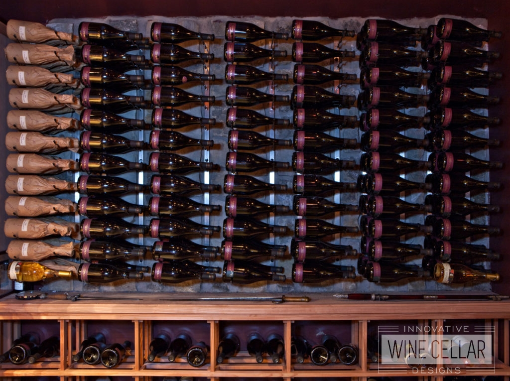 Metal Wine Racks Mounted to Wall with Wood Wine Shelves Beneath.