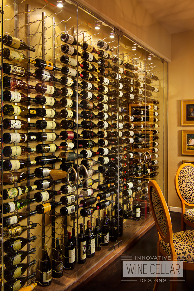 Contemporary glass wine cellar wall, custom design & install by Innovative Wine Cellar Designs.