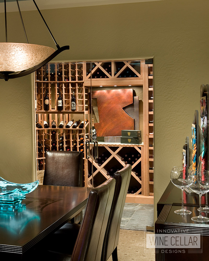 Custom Wood Wine Racks in Brightly Lit Wine Room with Art