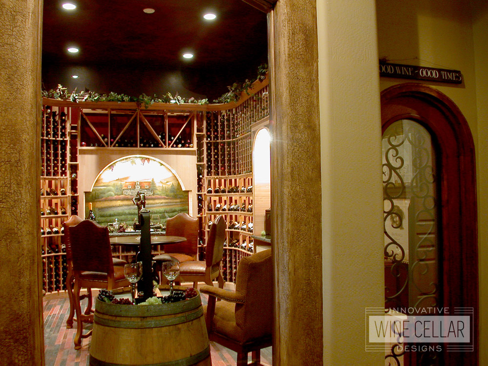 Traditional wine cellar & tasting room, custom design & install by Innovative Wine Cellar Designs.
