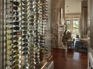 Contemporary glass wine wall cellar, custom design & install by Innovative Wine Cellar Designs.
