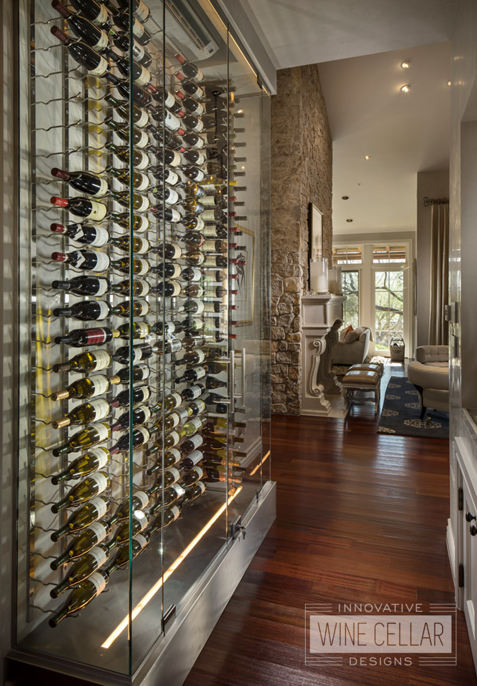 Contemporary glass wine wall cellar, custom design & install by Innovative Wine Cellar Designs.