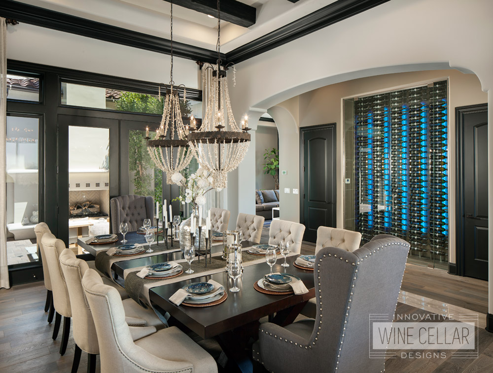 Wine wall with blue LED light accents in contemporary dining room area.