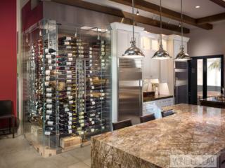 Contemporary corner kitchen glass wine cellar, custom design & install by Innovative Wine Cellar Designs.
