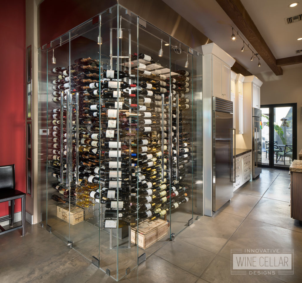 Contemporary corner kitchen glass wine cellar, custom design & install by Innovative Wine Cellar Designs.