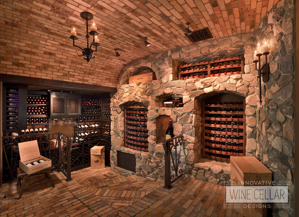 Stone & brick with cellar wine reclaimed wine barrel racking, custom design & install by Innovative Wine Cellar Designs.