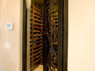 Custom Wrought Iron Wine Cellar Door with Iron Grape Vine Accents - By Innovative Wine Cellar Designs