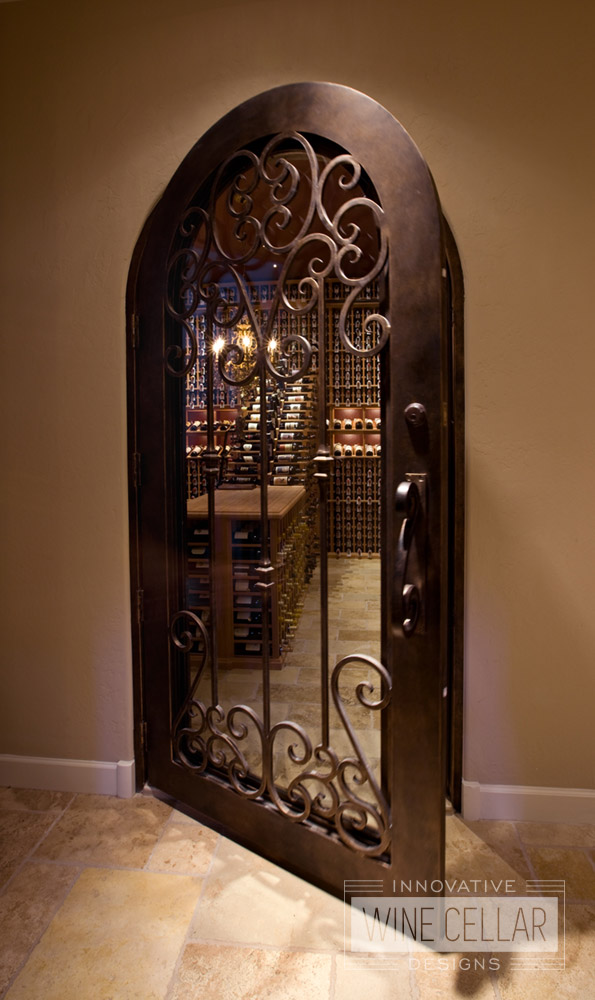 Custom Wine Cellar Door Design with Scrolled Wrought Iron Accents