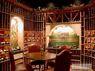 Traditional wine cellar & tasting room, custom design & install by Innovative Wine Cellar Designs.