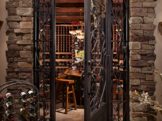 Custom Wrought Iron Wine Cellar Door with Iron Scrolls & Grape Vine & Leaf Accents - By Innovative Wine Cellar Designs