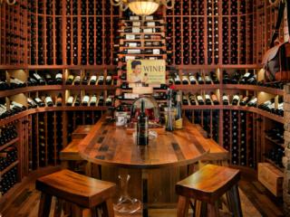 Traditional mahogany wine cellar, custom design & install by Innovative Wine Cellar Designs.