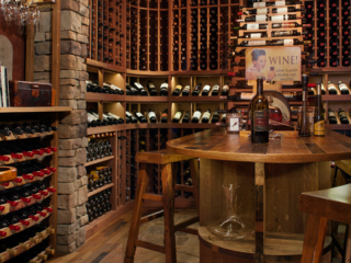 Reclaimed wine barrel & mahogany wine cellar, custom design & install by Innovative Wine Cellar Designs.
