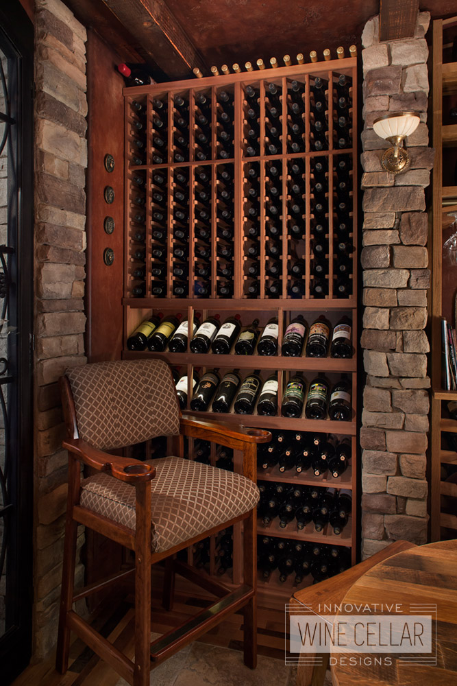 Traditional mahogany wine cellar, custom design & install by Innovative Wine Cellar Designs.