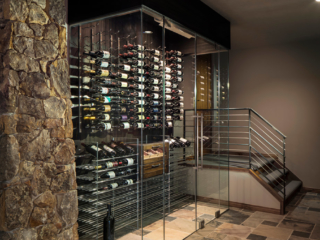 Contemporary wine cellar wall enclosed in glass doors feature floor and wall metal wine racking.