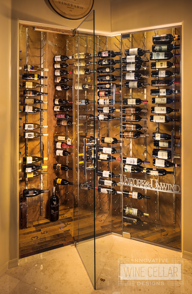 Converted corner into recessed wine wall storage room with glass doors.