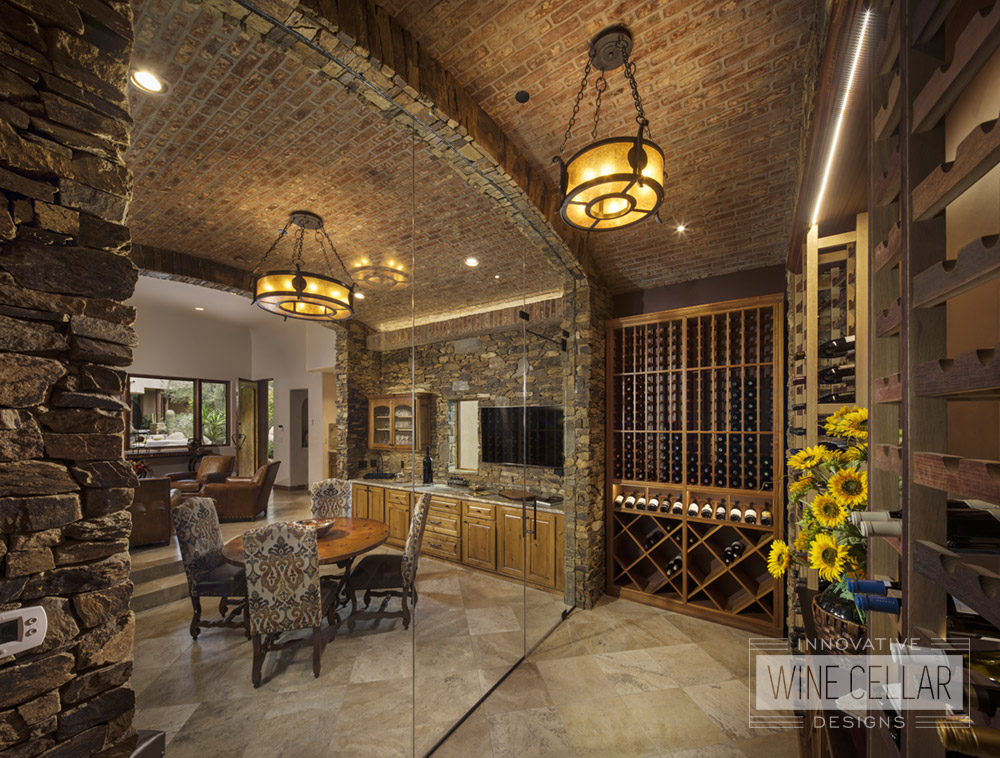 Traditional stone & brick wine cellar, custom design & install by Innovative Wine Cellar Designs.