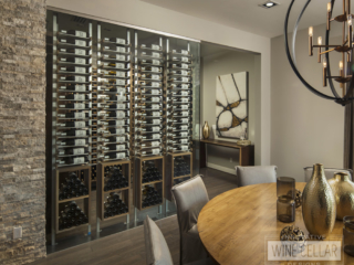 Glass wine room with metal and wood racking to match industrial contemporary decor.