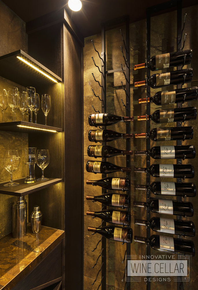 Wine cellar room with metal wine racks and dim lighting to match contemporary decor.