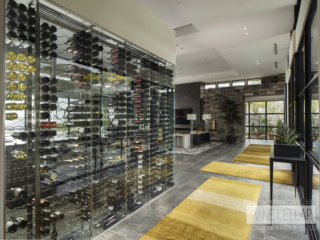 Modern kitchen wine wall cellar, custom design & install by Innovative Wine Cellar Designs.