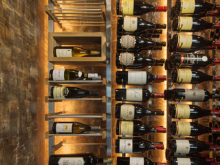 Mixed metal and wood wine racking and glowing backlighting.