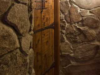 Custom Old World Style Wine Cellar Door made from Solid Wood and Iron Accents by Innovative Wine Cellar Designs.