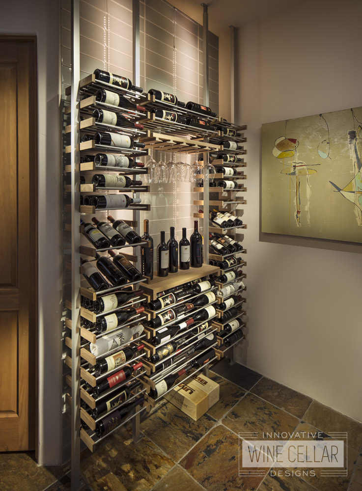 Modern open space wine storage using metal and wood accent wine bottle and glass racking.