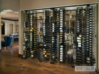 This glass wine wall cellar makes for a space saving, unique way to separate two rooms.