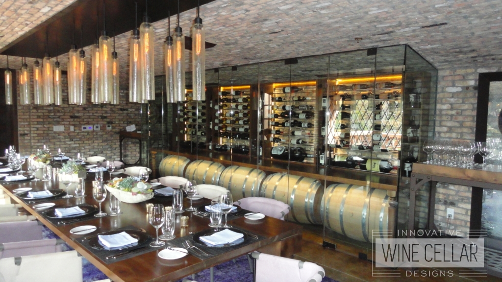 Glass Wine Cellar with Decorative Wine Barrels in Wine Cave