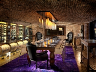 Intimate private dining room with glass enclosed wine wall