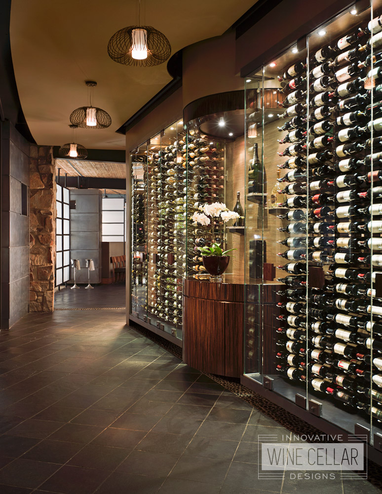 Greet your guests' taste buds as they enter your restaurant with a delicious display of wine in a custom glass wine cellar!