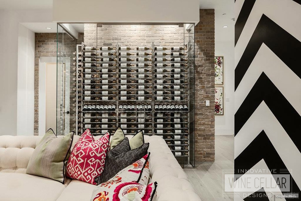Contemporary glass enclosed wine cellar, custom design & install by Innovative Wine Cellar Designs.