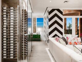 Contemporary glass enclosed wine cellar, custom design & install by Innovative Wine Cellar Designs.
