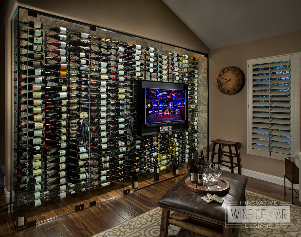 Recessed wine wall with glass doors in contemporary style living area.