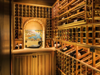 Traditional redwood wine storage room, custom design & install by Innovative Wine Cellar Designs.