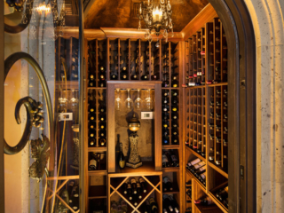 Traditional tuscan style wine cellar, custom design & install by Innovative Wine Cellar Designs.