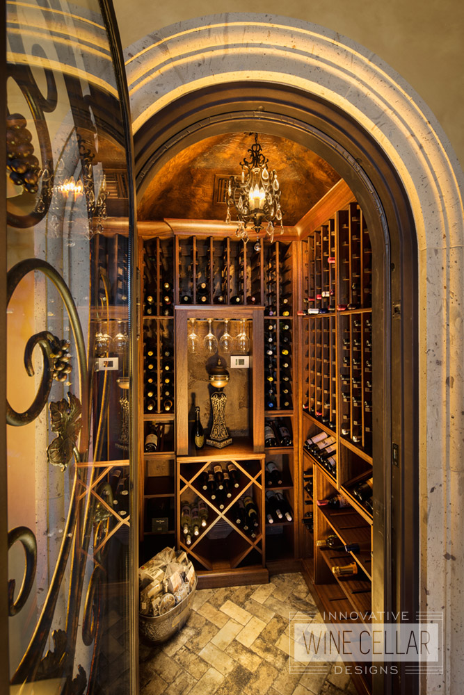 Traditional tuscan style wine cellar, custom design & install by Innovative Wine Cellar Designs.