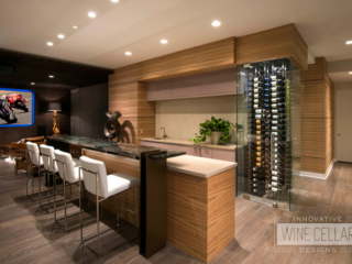 Wet bar area with converted end cap wall into wine storage area with glass walls.
