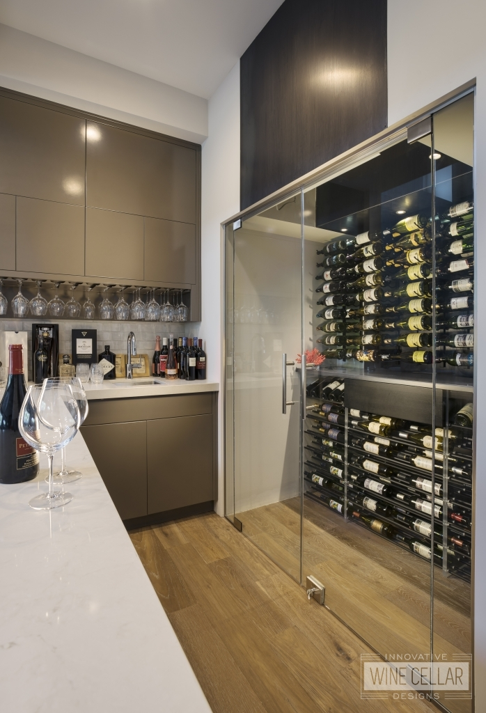 Contemporary small glass wine cellar in residential wet bar