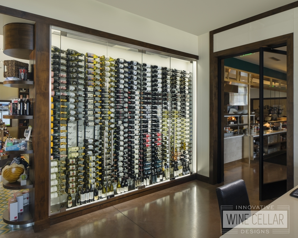 glass wine wall in clubhouse shop