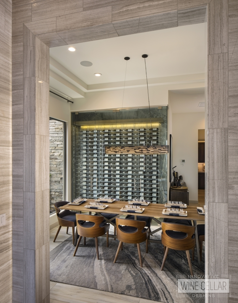 modern dining room with glass wine wall