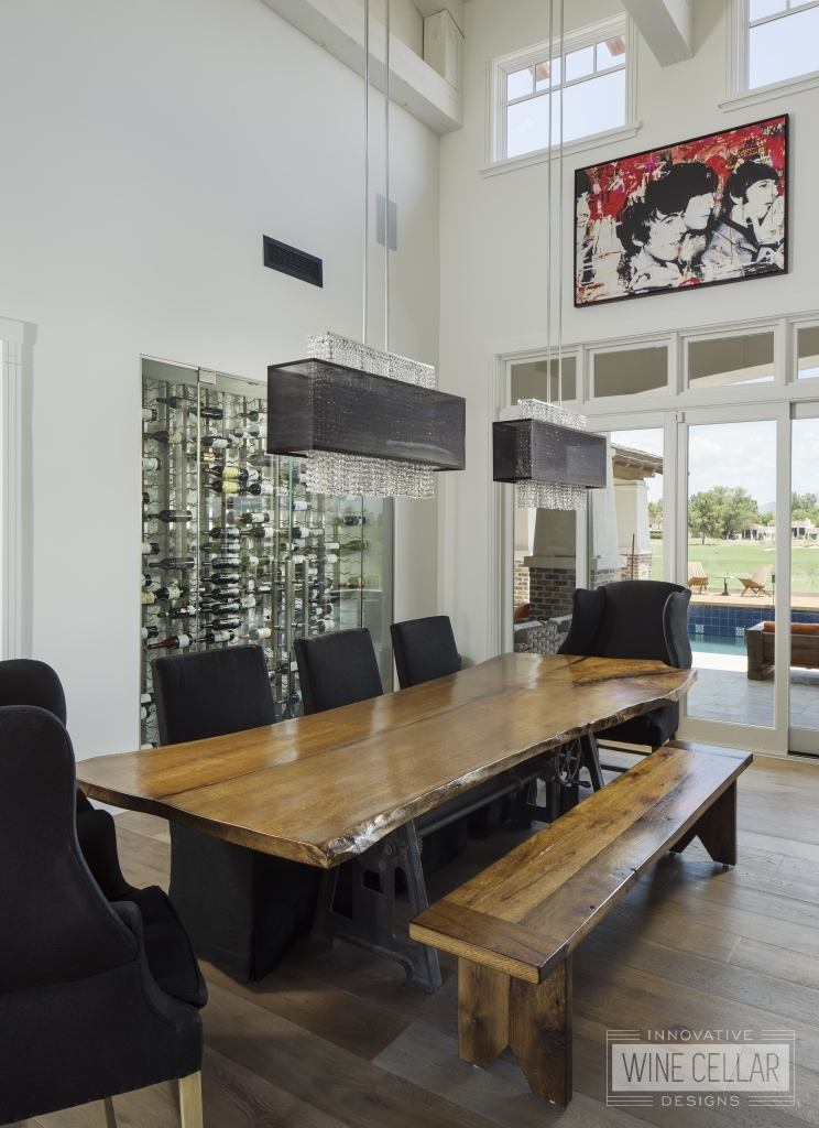 Urban contemporary dining room with glass wine wall