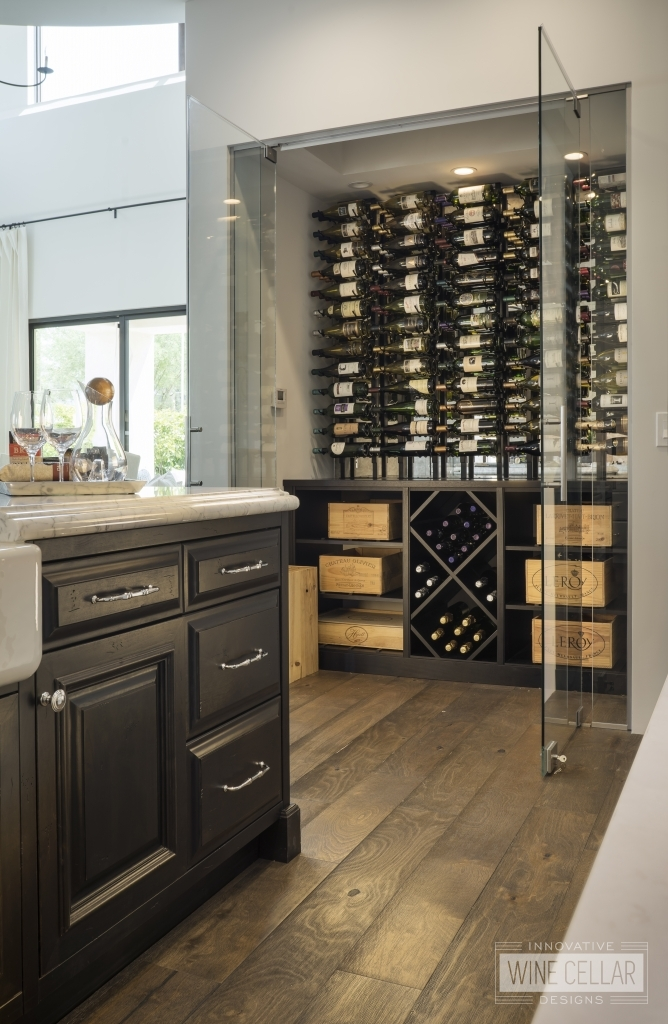 wine cellar in kitchen with glass doors