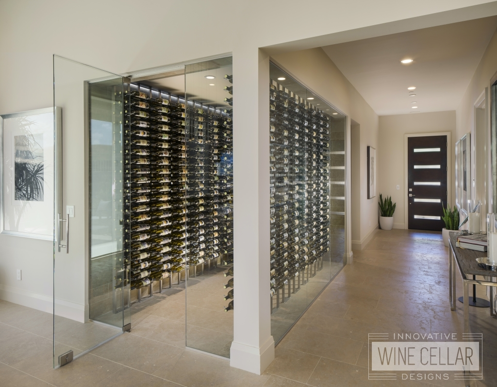 walk in glass wine cellar with floor to ceiling metal wine racks