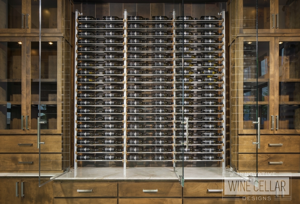 wine wall cabinets with open glass doors displaying wine